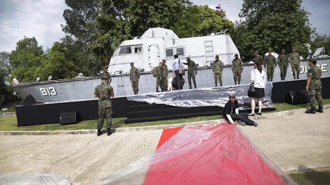 Thai military personnel and volunteers prepare for a memorial service to be held the next day, built around a police boat which was beached 10 years ago when the Asian tsunami struck, in Khao Lak, Thailand, Thursday, Dec. 25, 2014. Dec. 26 marks the 10th anniversary of one of the deadliest natural disasters in world history: a tsunami, triggered by a massive earthquake off the Indonesian coast, that left more than 230,000 people dead in 14 countries and caused about $10 billion in damage. (AP Photo/Wong Maye-E)