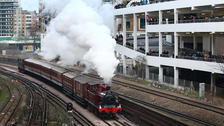 Metropolitan 1, a restored steam train built in 1898, travels from Kensington Olympia Tube station to Moorgate station in the City of London, Sunday, Jan. 13, 2013 as part of the celebrations for the 150th anniversary of the London Underground. The train traveled non-stop but moved at slow speed and was visible passing through a number of stations en route. (AP Photo/PA Gareth Fuller)UNITED KINGDOM OUT