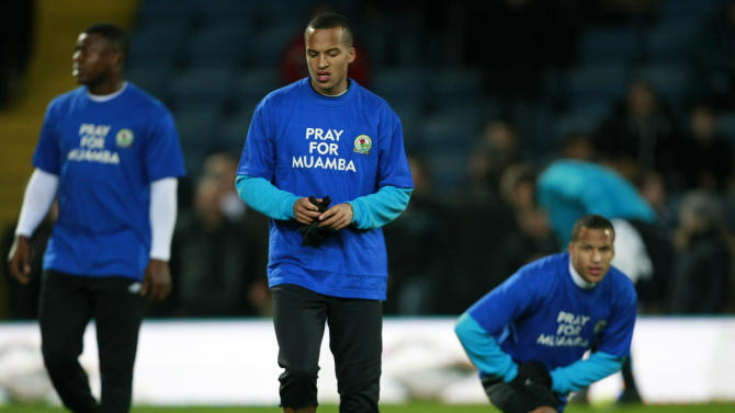 Blackburn's Marcus Olsson, center, and teammates wear T-shirts supporting Bolton Wanderers' Fabrice Muamba before their English Premier League soccer match against Sunderland at Ewood Park, Blackburn, England, Tuesday March 20, 2012. (AP Photo/Tim Hales)