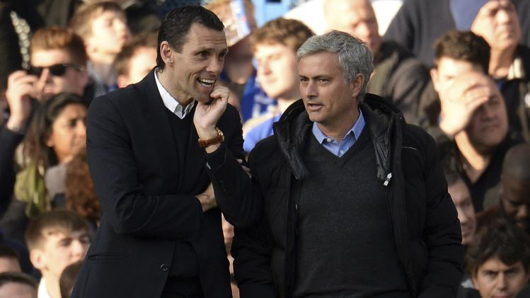 Chelsea's manager Mourinho speaks with his Sunderland counterpart Poyet during their English Premier League soccer match in London