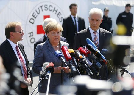 Merkel, heckled on visit to refugees, says no to xenophobia