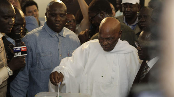 President Abdoulaye Wade casts his ballot for president at a polling station in his home Point E neighborhood of Dakar, Senegal Sunday, March 25, 2012. Senegalese voters are deciding Sunday whether to give their 85-year-old president another term in office, or instead back his one-time protege in a runoff election that could oust the incumbent of 12 years. (AP Photo/Rebecca Blackwell)