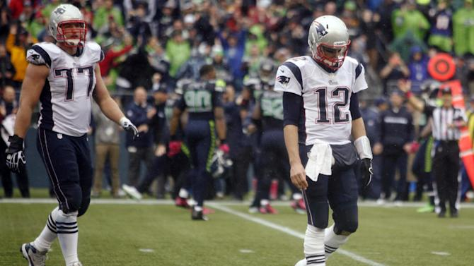 New England Patriots quarterback Tom Brady (77) and Nate Solder (77) walk off the field after their last play against  the Seattle Seahawks in the 24-34 loss to of an NFL football game, Sunday, Oct. 14, 2012, in Seattle. (AP Photo/John Froschauer)