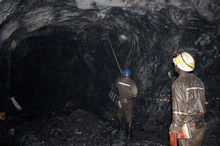 Mine workers are pictured at the Freda Rebecca gold mine in Bindura
