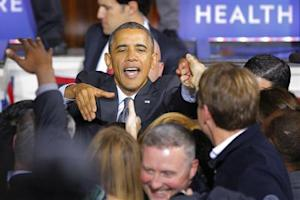 U.S. President Barack Obama greets audience members after speaking about the Affordable Care Act at Faneuil Hall in Boston