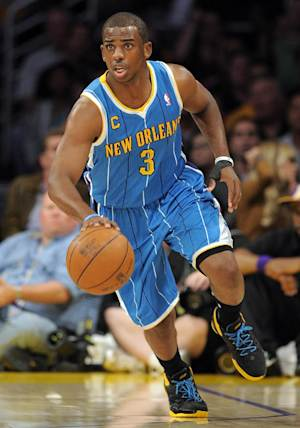 FILE - In this April 26, 2011, file photo, New Orleans Hornets guard Chris Paul drives the ball downcourt during the first half in Game 5 of a first-round NBA basketball playoff series against the Los Angeles Lakers in Los Angeles. The framework of a three-team trade is in place to send Paul to the Los Angeles Lakers pending details of the transaction still being worked on Thursday, Dec. 8, 2011, according to a person familiar with the negotiations. (AP Photo/Mark J. Terrill, File)