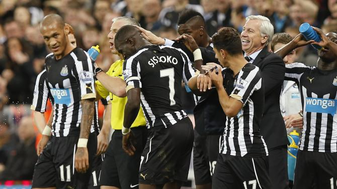 Newcastle United manager Pardew celebrates with goal scorer Newcastle United's Sissoko during their English Premier League soccer match in Newcastle