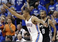 Oklahoma City Thunder guard Russell Westbrook (0) and San Antonio Spurs guard Tony Parker (9) of France react during the first half of Game 4 in the NBA basketball playoffs Western Conference finals, Saturday, June 2, 2012, in Oklahoma City. (AP Photo/Sue Ogrocki)