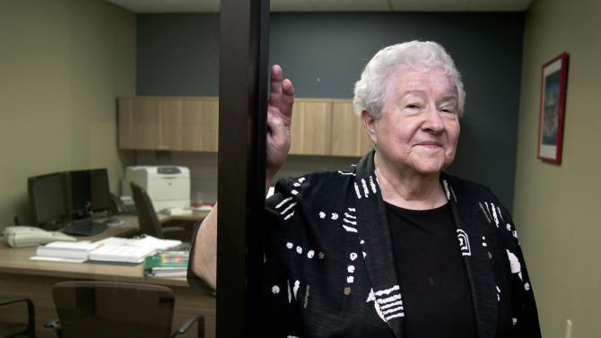 FILE - This Aug. 1, 2012 file photo shows Janice Durflinger at her workplace in Lincoln, Neb., Wednesday, Aug. 1, 2012. The 56 million people who get Social Security benefits shouldn't expect a big increase in their monthly payments next year. The cost-of-living adjustment, or COLA, is determined by a government measure of inflation, and the measure shows that consumer prices have barely increased over the past year _ a revelation that might come as a surprise to seniors who spend more of their income on health care than younger adults. (AP Photo/Nati Harnik, File)