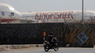 Kingfisher Airlines aircraft parked at Chatrapati Shivaji International Airport in Mumbai. Kingfisher will remain grounded for another week after employees who have not been paid for the last seven months refused to go back to work, according to the company