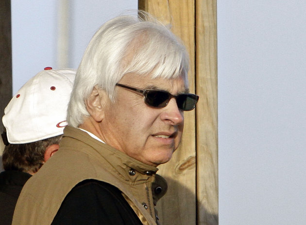 All of Fame trainer Bob Baffert watches two of his Kentucky Derby hopefuls, Bodemeister and Liaison, train at Churchill Downs in Louisville, Ky., Tuesday, April 24, 2012. (AP Photo/Garry Jones)