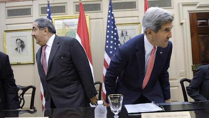 """Secretary of State John Kerry and Iraqi Foreign Minister Hoshyar Zebari take their seats at the State Department in Washington, Thursday, Aug. 15, 2013, before a meeting. Kerry met Thursday with the foreign minister, and said that since he visited Baghdad in March, some progress has been made to stop Iraq from being a transit zone for weapons. But he says """"very significant"""" progress has yet to be made. (AP Photo/Susan Walsh)"""