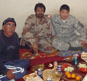 """This 2008 photo provided by Stephen Lee shows Lee, right, having a meal with Afghans in Paktika province, Afghanistan. Lee was still in Afghanistan - his second deployment to the war zone - when he began looking at colleges. The California native settled on the University of Wisconsin-Madison and had already begun his studies when he learned of the coming changes to his GI Bill benefits. He was looking at an extra $20,000 a year out of pocket. """"It was a HUGE jump,"""" says Lee, whose military occupational specialty, or MOS, was human intelligence collector. """"And that's when I had to start thinking really hard about whether or not I was going to be able to afford school, or whether I'd have to take a year off and work while I tried to get in-state status."""" Around that time, the state launched its Yellow Ribbon Program, under which the university and the VA agree to split the difference between the resident and nonresident rate. There was only a limited amount set aside for the program, but Lee lucked out. """"This uncertainty almost took me out of school,"""" he says. (AP Photo/Stephen Lee)"""