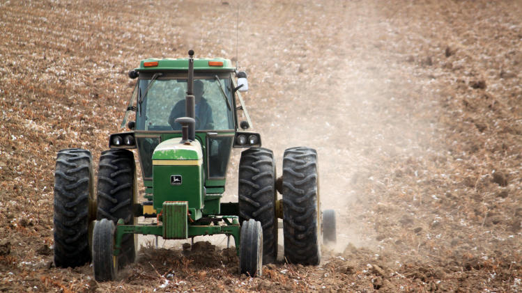 In this March 19, 2013 photo, a tractor plows a cotton field in Hatch, N.M., in preparation for the spring growing season. Farmers across New Mexico are worried about dwindling water supplies as the state enters its third straight year of drought. (AP Photo/Susan Montoya Bryan)