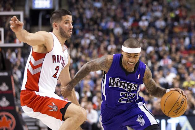 Sacramento Kings' Isaiah Thomas, right, drives past Toronto Raptors' Greivis Vasquez during first half NBA basketball action in Toronto on Friday March 7, 2014