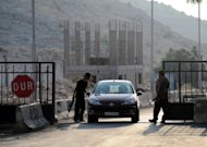 Syrian gunmen open the Bab al-Hawa border gate between Turkey and Syria on July 21. Turkey has sent batteries of ground-to-air missiles to the border with Syria, boosting its firepower as rebels in Syria seized several border posts