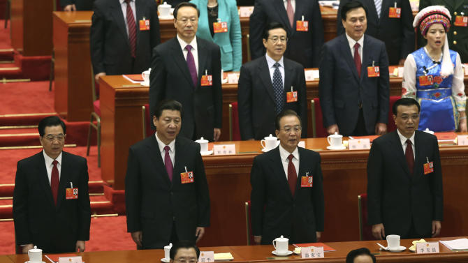 Front row from left, China's former President Hu Jintao, newly appointed President Xi Jinping, newly installed Premier Li Kiqiang and former Chinese Premier Wen Jiabao sing the Chinese national anthem at the closing session of the National People's Congress at the Great Hall of the People in Beijing China, Sunday, March 17, 2013.  China's new leader pledged a cleaner, more efficient government Sunday as the country's ceremonial legislature wrapped up a pivotal session that installed the latest generation of communist leaders in a once-a-decade transfer of power.  (AP Photo/Kin Cheung)
