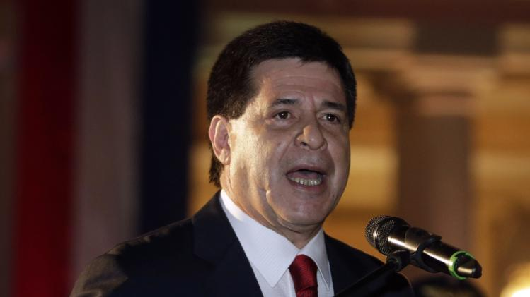 Paraguay's President Cartes speaks before lighting up a Christmas tree bearing the colors of the Paraguayan national flag, in front of the Lopez Palace in Asuncion