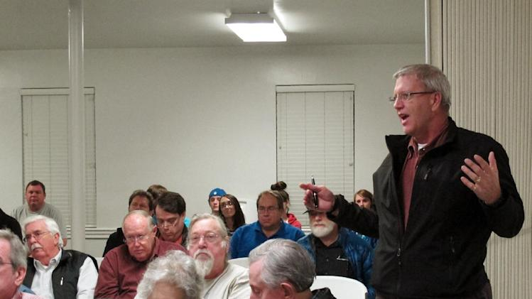 A member of the Mid-South Tea Party asks a question during a meeting, Thursday, Nov. 17, 2011, in Bartlett, Tenn. (AP Photo/Adrian Sainz)