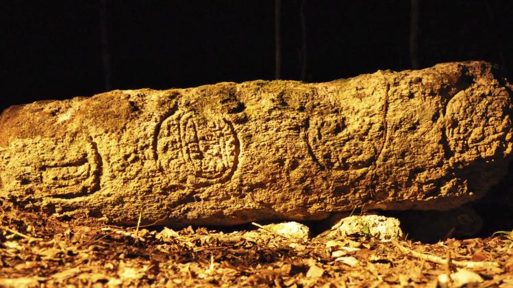 A photograph released to Reuters on August 22, 2014 shows a piece of a stela from an ancient Mayan city in Lagunita