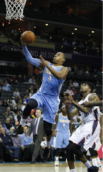 Denver Nuggets guard Randy Foye (4) scores against Charlotte Bobcats guard Chris Douglas-Roberts during the second half of an NBA basketball game in Charlotte, N.C., Monday, March 10, 2014. Charlotte