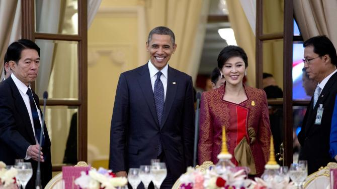 U.S. President Barack Obama, second left, and Thai Prime Minister Yingluck Shinawatra, second right, arrive for an official dinner at Government House in Bangkok, Thailand, Sunday, Nov. 18, 2012. (AP Photo/Carolyn Kaster)