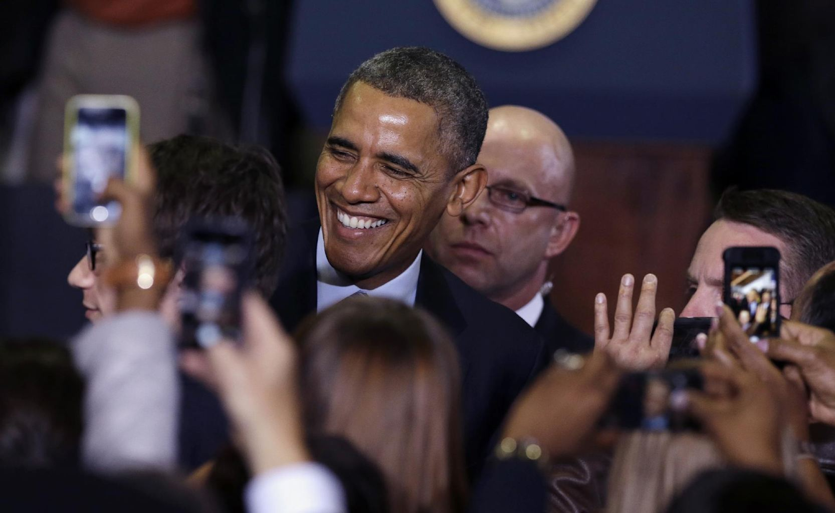 greets visitors after signing the farm bill, Friday, Feb. 7, 2014 ...