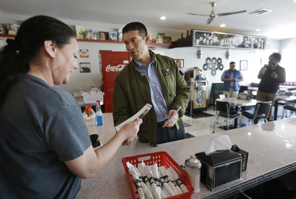 Republican candidate for the U.S. Senate businessman and former Navy SEAL Gabriel Gomez, center, speaks with waitress Michelle Camelio, of Marshfield, Mass., left, during a campaign stop at a restaurant, in Marshfield, Monday, April 29, 2013. (AP Photo/Steven Senne)