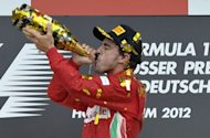 Ferrari&#39;s Spanish driver Fernando Alonso celebrates on the podium at the Hockenheimring circuit during the German Formula One Grand Prix. Alonso extended his lead in this year&#39;s Formula One drivers&#39; world championship on Sunday when he drove to a flawless victory for Ferrari in the German Grand Prix
