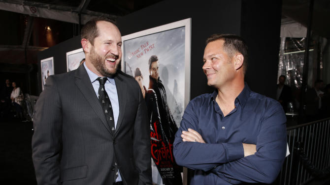 "Producer Beau Flynn and Prodcuer Kevin Messick arrive at the premiere of ""Hansel & Gretel Witch Hunters"" on Thursday Jan. 24, 2013, in Los Angeles.  (Photo by Todd Williamson/Invision/AP)"