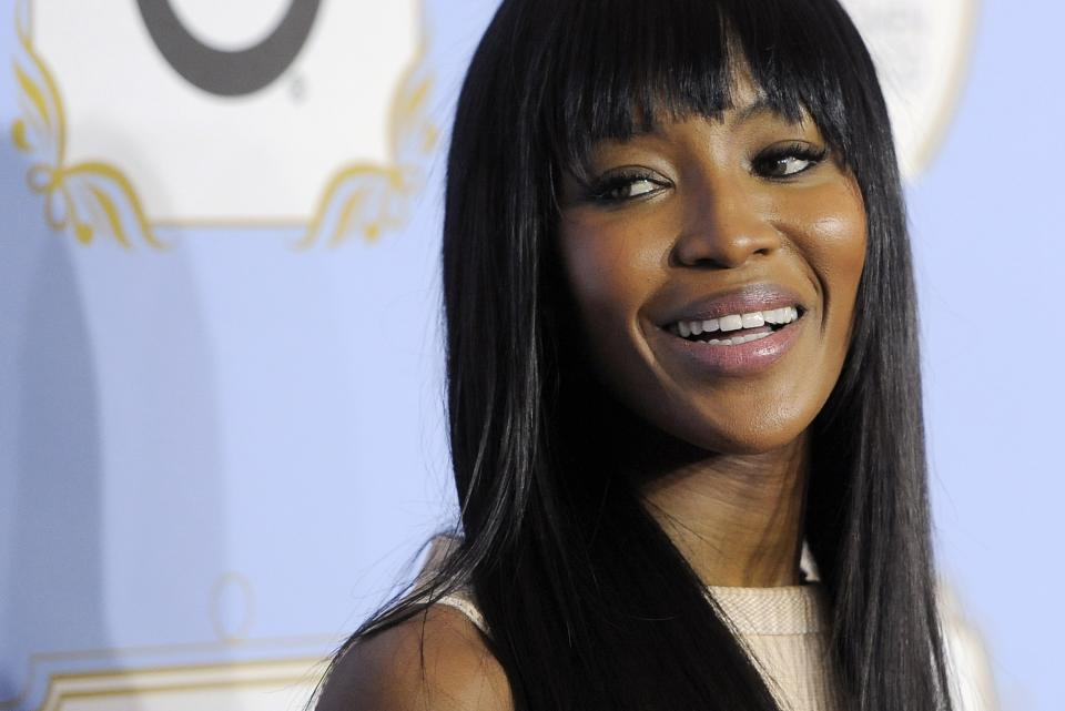 Model Naomi Campbell looks down the red carpet at the 6th Annual Black Women in Hollywood Luncheon at the Beverly Hills Hotel on Thursday, Feb. 21, 2013 in Los Angeles. (Photo by Chris Pizzello/Invision/AP)