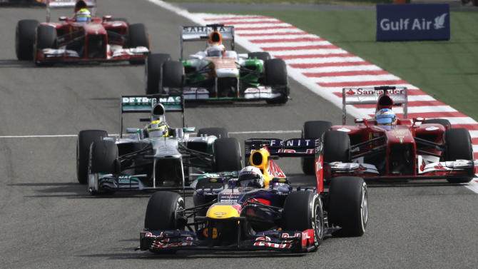 Red Bull driver Sebastian Vettel of Germany, center, leads Ferrari driver Fernando Alonso of Spain, right, and Mercedes driver  Nico Rosberg of Germany, during the Formula One Grand Prix at the Formula One Bahrain International Circuit in Sakhir, Bahrain, Sunday, April 21, 2013. (AP Photo/Hassan Ammar)