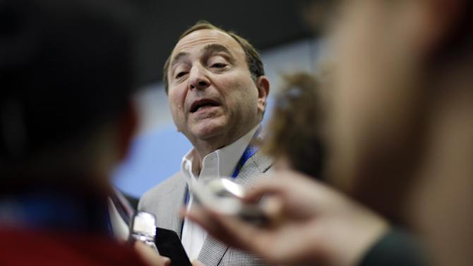 NHL Commissioner Gary Bettman answers questions about hockey issues at a news conference at the 2014 Winter Olympics, Tuesday, Feb. 18, 2014, in Sochi, Russia