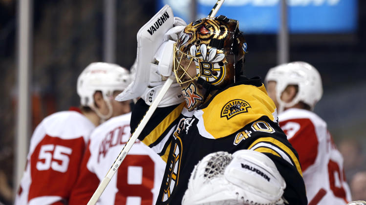 Boston Bruins goalie Tuukka Rask grimaces as Detroit Red Wings celebrate Pavel Datsyuk's goal during the third period of Detroit's 1-0 win in Game 1 of a first-round NHL playoff hockey game in Boston on Friday, April 18, 2014. (AP Photo/Winslow Townson)