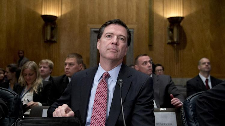 FBI Director James Comey takes his seat on Capitol Hill in Washington, Thursday, Nov. 14, 2013, prior to testifying before the Senate Homeland Security and Governmental Affairs Committee hearing to examine threats to the homeland. (AP Photo/Carolyn Kaster)