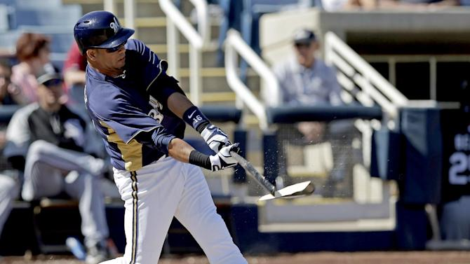 Milwaukee Brewers' Aramis Ramirez breaks his bat as he grounds out during the fourth inning of an exhibition spring training baseball game against the Chicago White Sox, Thursday, Feb. 28, 2013, in Phoenix. (AP Photo/Morry Gash)