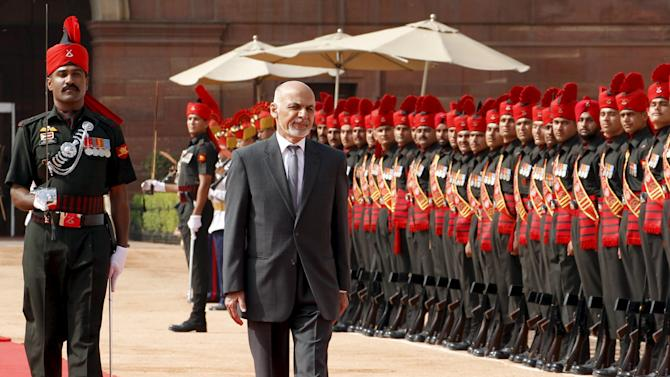 Afghanistan's President Ashraf Ghani inspects a guard of honour during his ceremonial reception at the forecourt of India's presidential palace Rashtrapati Bhavan, in New Delhi