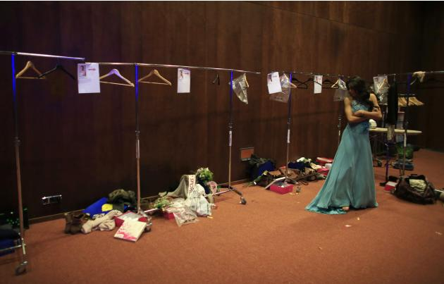 "Contestant in the ""Miss World Sevilla"" pageant Molina stands backstage after being eliminated in the first round, in Seville"