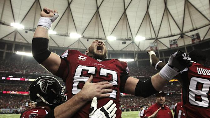 Atlanta Falcons center Todd McClure (62) celebrates on the sidelines following kicker Matt Bryant's winning 49-yard field goal against the Seattle Seahawks during the fourth quarter of their NFC divisional playoff NFL football game, Sunday, Jan. 13, 2013, in Atlanta. The Falcons won 30-28. (AP Photo/Atlanta Journal-Constitution, Curtis Compton)  MARIETTA DAILY OUT; GWINNETT DAILY POST OUT; LOCAL TV OUT; WXIA-TV OUT; WGCL-TV OUT