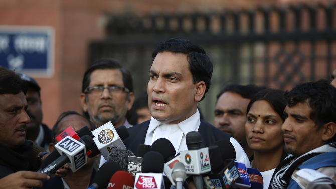 A.P Singh, lawyer for one of the accused, speaks to journalists outside the Saket district court complex where the five men facing charges of rape and murder of a 23-year-old woman aboard a moving bus in the capital last month stand trial, in New Delhi, India, Monday, Jan. 21, 2013. Legal proceedings in the fatal gang-rape attack on the student in India's capital began Monday in a new fast-track court set up to deal specifically with crimes against women that has stirred debate over how best to deliver justice to rape victims.(AP Photo/ Saurabh Das)