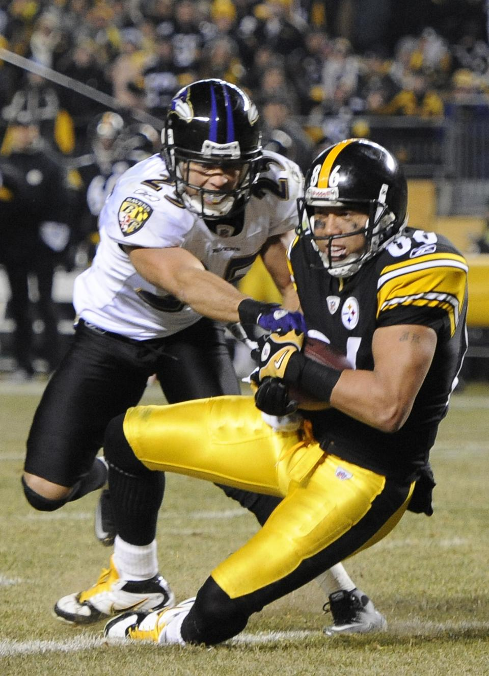Pittsburgh Steelers wide receiver Hines Ward (86) catches an 8-yard touchdown pass as the Baltimore Ravens cornerback Chris Carr defends during the second half of an NFL divisional football game in Pittsburgh, Saturday, Jan. 15, 2011. (AP Photo/Don Wright)