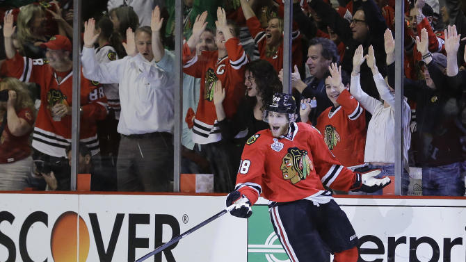 Chicago Blackhawks right wing Patrick Kane (88) reacts after scoring against the Boston Bruins in the first period during Game 5 of the NHL hockey Stanley Cup Finals, Saturday, June 22, 2013, in Chicago. (AP Photo/Nam Y. Huh)