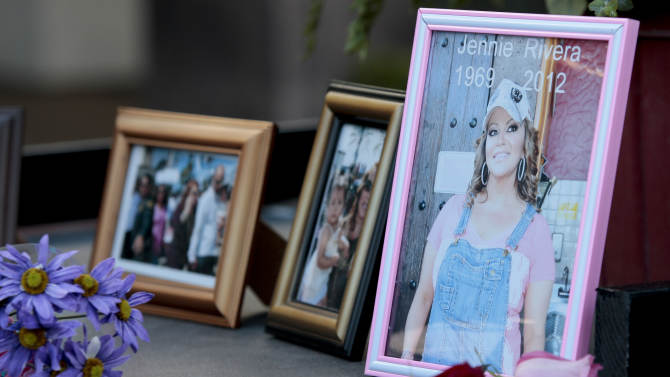 Fans leave photos and flowers at a makeshift shrine for singer Jenni Rivera at Plaza Mexico in Lynwood, Calif. Monday, Dec. 10, 2012. U.S. authorities confirmed Monday that Jenni Rivera, a U.S.-born singer whose soulful voice and openness about her personal troubles made her a Mexican-American superstar, was killed Sunday in a plane crash in northern Mexico. (AP Photo/Jason Redmond)