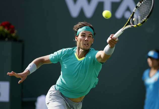 Nadal returns a serve against Del Potro during men's singles final match at the BNP Paribas Open ATP  tennis tournament in Indian Wells