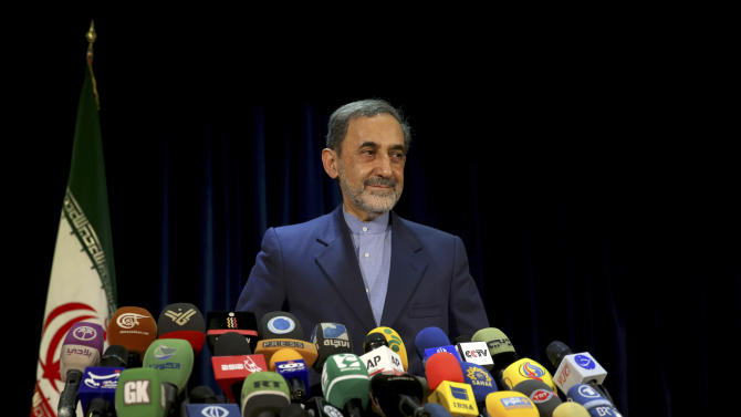 Former Iranian Foreign Minister, Ali Akbar Velayati, a senior advisor to supreme leader Ayatollah Ali Khamenei, attends a press conference after registering his candidacy for the upcoming presidential election, at the election headquarters of the interior ministry in Tehran, Iran, Saturday, May 11, 2013. Iranian election authorities say several new high-profile politicians including hardliners, reformists, and allies of outgoing President Mahmoud Ahmadinejad have registered for the June 14 presidential elections. The campaign is taking shape as open season on Ahmadinejad's legacy and his combative style that bolstered his stature among supporters but alarmed critics. Ahmadinejad is barred by law from seeking a third term due to term limits under Iran's constitution. (AP Photo/Ebrahim Noroozi)