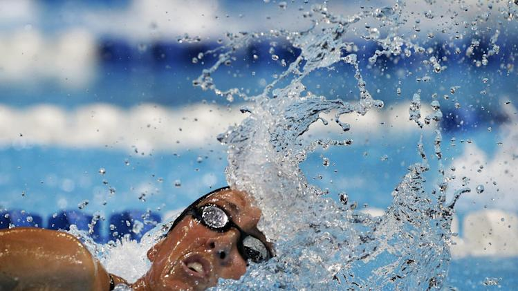 Janet Evans swims in the women's 800-meter freestyle preliminaries at the U.S. Olympic swimming trials, Saturday, June 30, 2012, in Omaha, Neb. (AP Photo/Mark Humphrey)