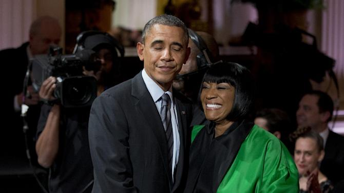 "President Barack Obama greets Patti LaBelle after she performed ""Over the Rainbow"" during the ""In Performance at the White House: Women of Soul"" in the East Room of the White House in Washington, Thursday, March 6, 2014, hosted by President Barack Obama, and first lady Michelle Obama. The program included performances by Tessanne Chin, Melissa Etheridge, Aretha Franklin, Ariana Grande, Janelle Monáe and Jill Scott. (AP Photo/Manuel Balce Ceneta)"