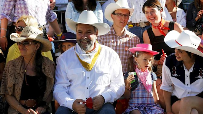 Federal NDP Leader Mulcair and his wife Catherine enjoy the Calgary Stampede parade in Calgary