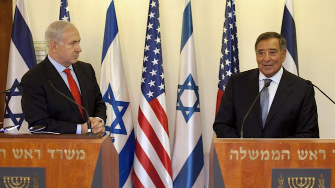 Israeli Prime Minister Benjamin Netanyahu, left, listens as U.S. Defense Secretary Leon Panetta speaks during a meeting at the Prime Minister's office in Jerusalem, Wednesday, Aug. 1, 2012. Israel's threats to attack Iran and the violence convulsing Syria top the agenda of Panetta's meetings Wednesday with Israeli government leaders. (AP Photo/Sebastian Scheiner, Pool)