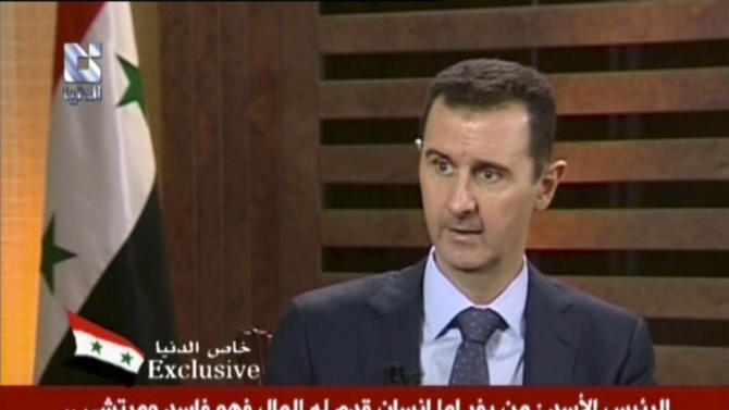 In this image made from video broadcast Wednesday, Aug. 29, 2012 on Addounia TV, Syrian President Bashar Assad speaks at an unknown location. Assad said in a broadcast Wednesday that his regime needs more time to win the civil war, acknowledging that his forces are struggling to contain the rebel challenge. (AP Photo) SYRIA OUT, TV OUT